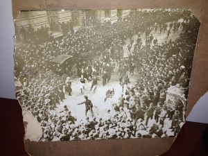Lorden at the finish line of the 1903 race with the huge crowd being held back by police